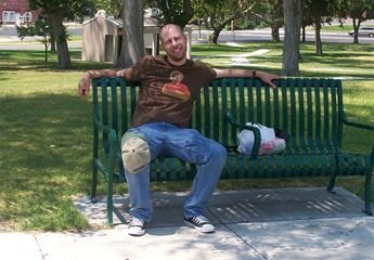 a photo of me, sitting on a bench